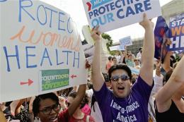 US high court upholds heart of Obama health law