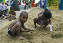 Children from a poor neighbourhood in Santo Domingo play with sand