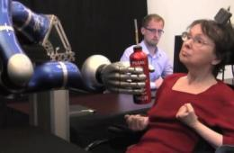 Paralyzed individuals use thought-controlled robotic arm to reach and grasp