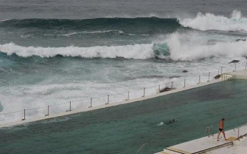 File photo shows huge surf near Sydney's Bondi beach, as study reveals Australian surf kills more people than bushfires, cyclone