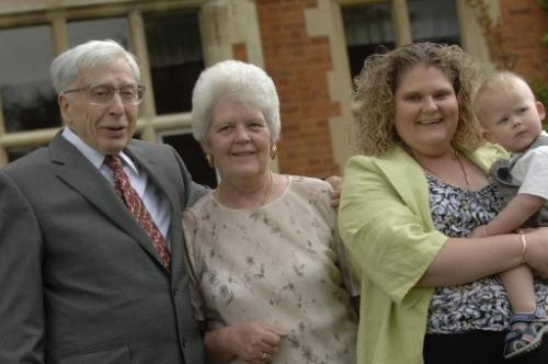 A picture from July 12, 2008 of the world's first IVF baby Louise Brown (2nd R) and Robert Edwards in Bourn, England