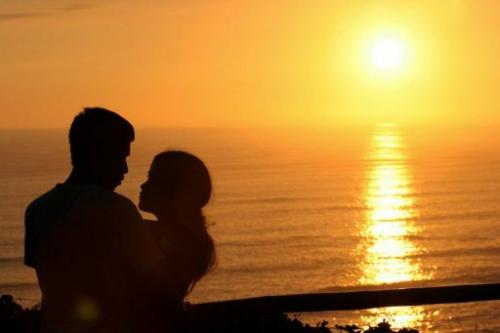 """A young couple cuddle while watching the sunset in the """"Park of Love"""" in Lima, Peru on February 14, 2006"""