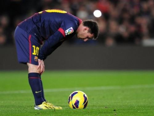 Lionel Messi concentrates prior to a penalty kick at the Camp Nou stadium in Barcelona on January 6, 2013