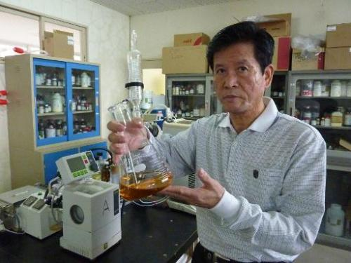 Shinkichi Tawada, professor of the faculty of Agriculture at the University of the Ryukyus, displays an extract of 'getto' essen