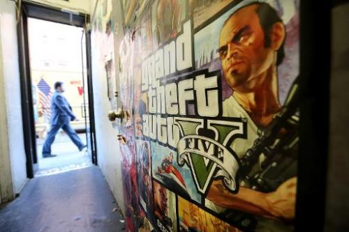A poster promoting Grand Theft Auto V is attached to a wall at a video games shop on September 18, 2013 in New York City