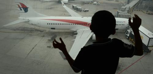 Coping with the trauma of missing flight MH370