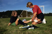 Portable shade structure use high for soccer-playing youth